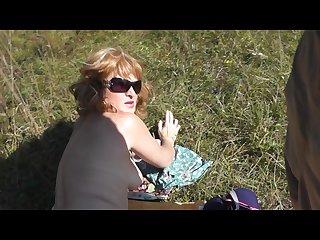 Pervert masturbate on sunbathing naked woman on wild beach and cumshot pov