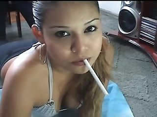 Cute latina smokes a cigarette on a webcam brazil