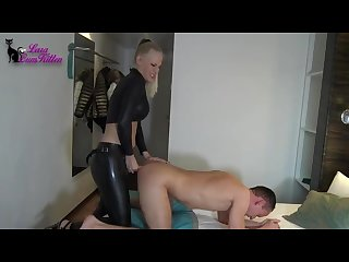 German mistress in latex humiliates her sub with a strapon
