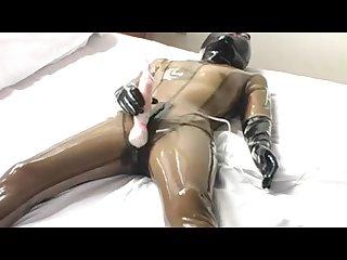 Japanese latex doll masturbates and self fist yobi 18