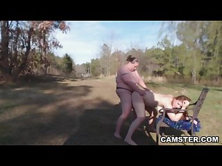 Lesbians with big tits use strap on during outdoor Picnic