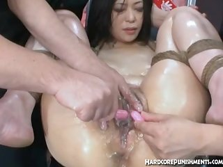 Sexy oriental babe is tied up with two vibrating bullets on her pussy