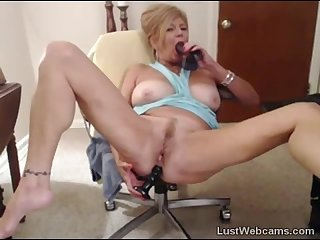 Blonde granny fucks her pussy and ass with dildo on webcam