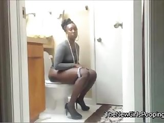 Ebony girl pooping on the toilet