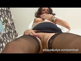 Zadi rubs and fingers her pussy in the office