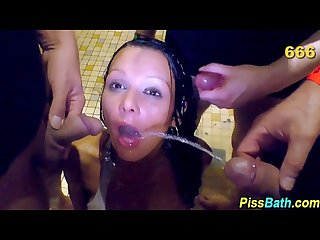 Sexy slut gets piss bath in urinal