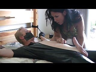 Guy tied and gagged on the bed by woman and she arouse man