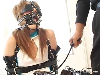 Blindfolded and masked asian girl gets teased by master with sex toys