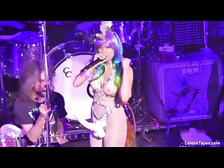 Miley Cyrus Shows Off Her Slim Body With Huge Dildo On A Stage