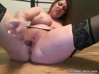 Chubby cam girl masturbates with a dildo