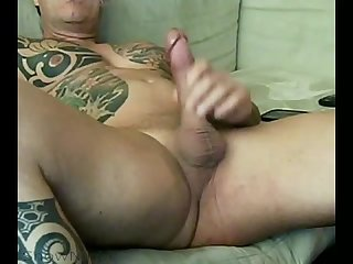 Tattooed straight 40 something muscle man jerk off with rare cumshot