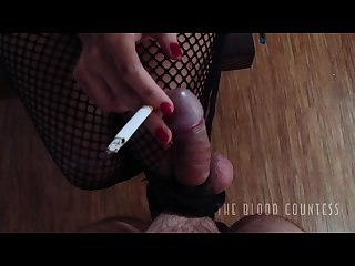 Mistress teasing and slapping tied up dick and balls while smoking