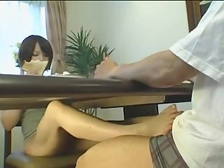 Asian footjob under the table