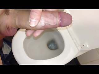 Dirty boy is playing with penis in public toilet