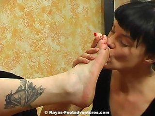 Lesbian worshiping her mature mistresses feet