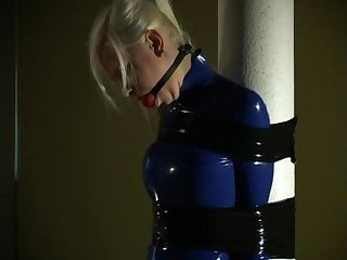 Lola blue rubber minidress tape bound to post