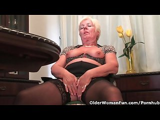Chubby granny in black stockings masturbates with dildo
