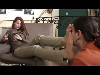 Goddess Victoria drinks wine and has her feet licked by a slave