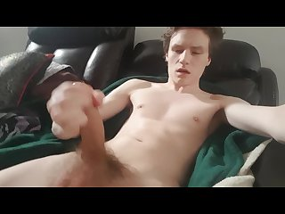 Young guy with hung uncut cock jerks off