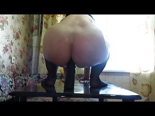 Milf fucks her ass dildo
