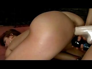 Busty hogtied girl getting fucked with strapon fingered in doggy by her mistress in the dungeon