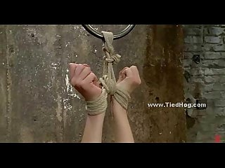 Redhead with big boobs hanged in bdsm