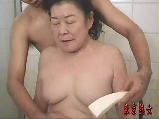 Japanese granny enjoying make love