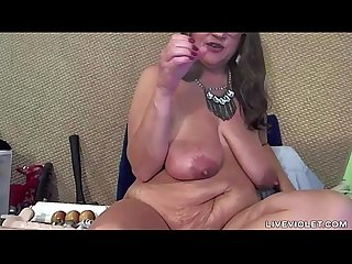 Dirty talking mature goddess rubbing meaty pussy lips