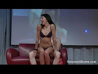 Attractive stripper massages a guys cock on the stage