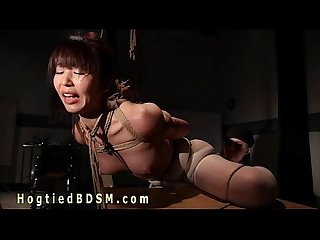 Brunette asian nurse in hogtied