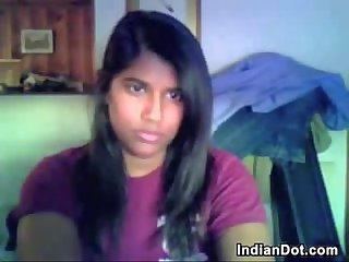 Cute indian chick strips and plays alone