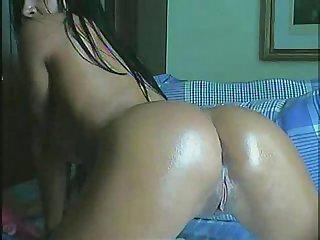 Brazilian whore takes dildo in ass
