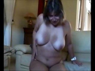 Horny amateur strokes her bushy cunt