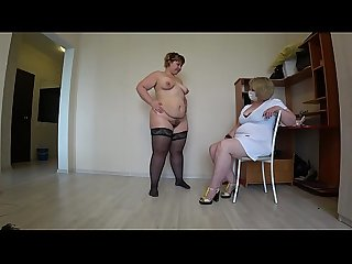 Mature nurse helps a plump lesbian with orgasm problems, fisting in medical gloves...