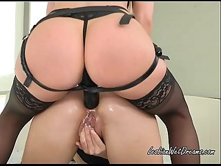 Annika rubs her pussy while ashley pounds her asshole with the black strap on