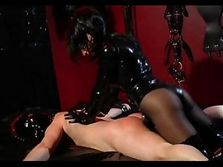 Fucked by a latex mistress in bondage bed