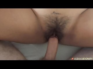 Asian gets her pussy hammered by big white cock