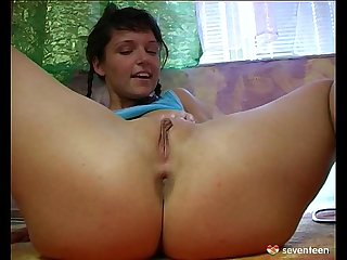 Young girl plays her white vibrator on the floor