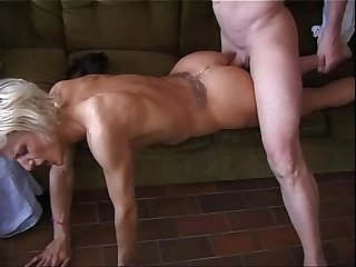A young blonde is violently banged by two men