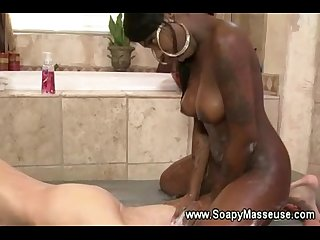 Ebony babe sucks and tugs white guy