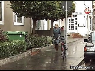Mature slut pisses all over the place