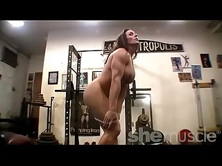 Nude Woman Bodybuilder Poses in the Gym