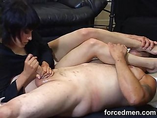 Mistress masturbates a slave and rests her feet on his face