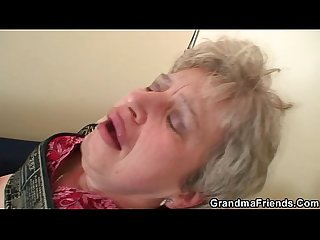 Grandma in black stockings sucks and rides at same time