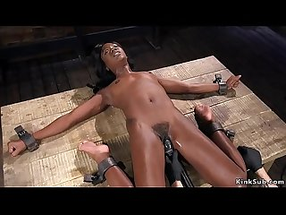 Hairy ebony rides machine in bondage