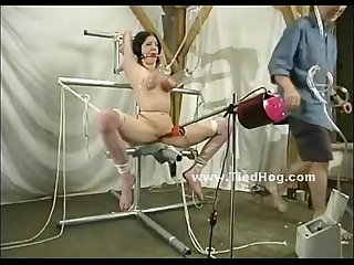 Brunette is tied up and suspended upside down while having her cunt penetrated