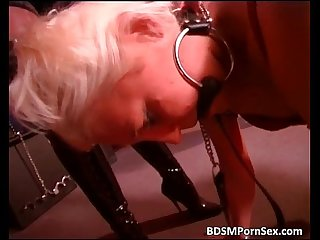 Strange BDSM play with two mistresses