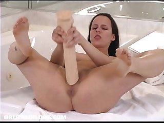 Horny amateur slams a long brutal dildo deep in her pussy