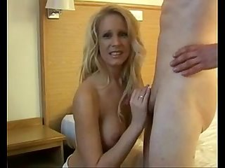 MILF gets a hot facial from young boy - more videos on - www.69SexLive.com
