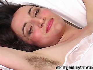 Alexandra gets twitching orgasm from fingering hairy pussy